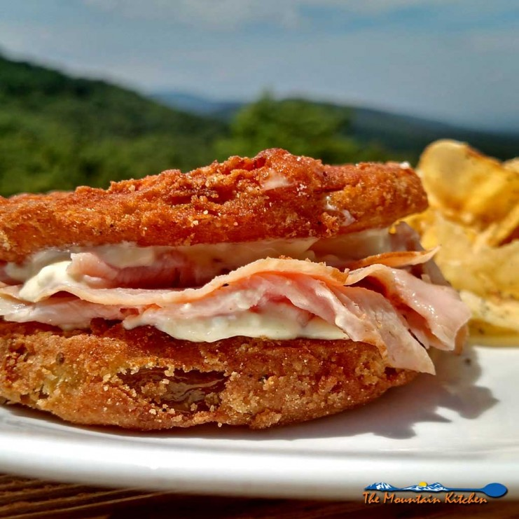 Firm tangy, crisp fried green tomato slices take on a whole new meaning with salty ham and sour mayo dressing in these fried green tomato sandwiches. | TheMountainKitchen.com
