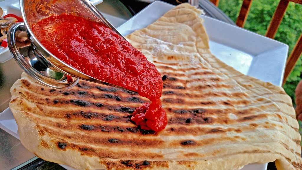 How to make grilled pizza on a charcoal grill. | TheMountainKitchen.com