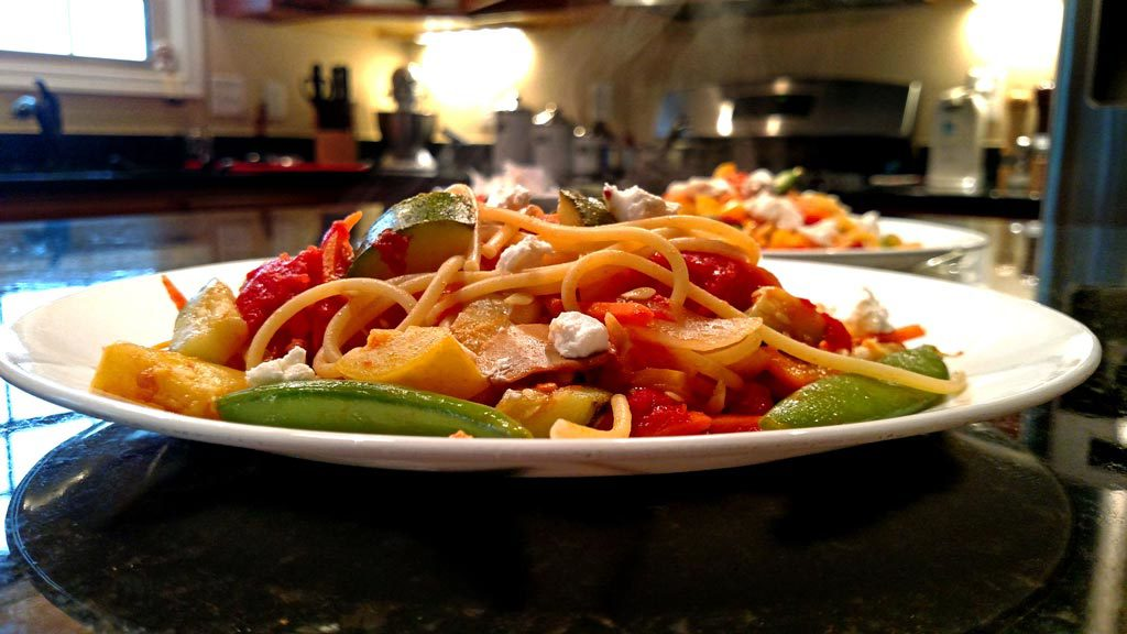 steaming plate of pasta primavera