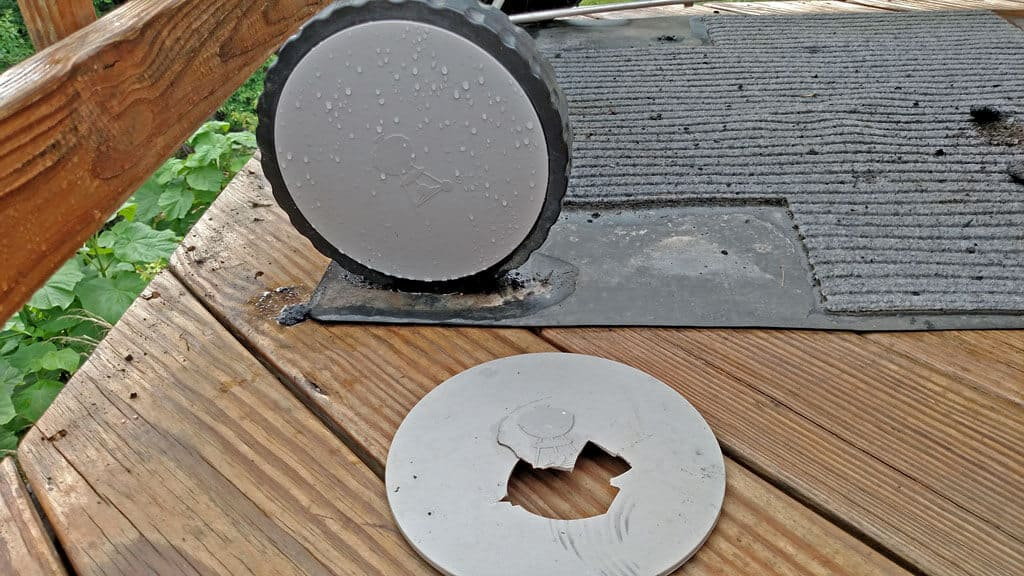a broken grill wheel cover and a fixed cover
