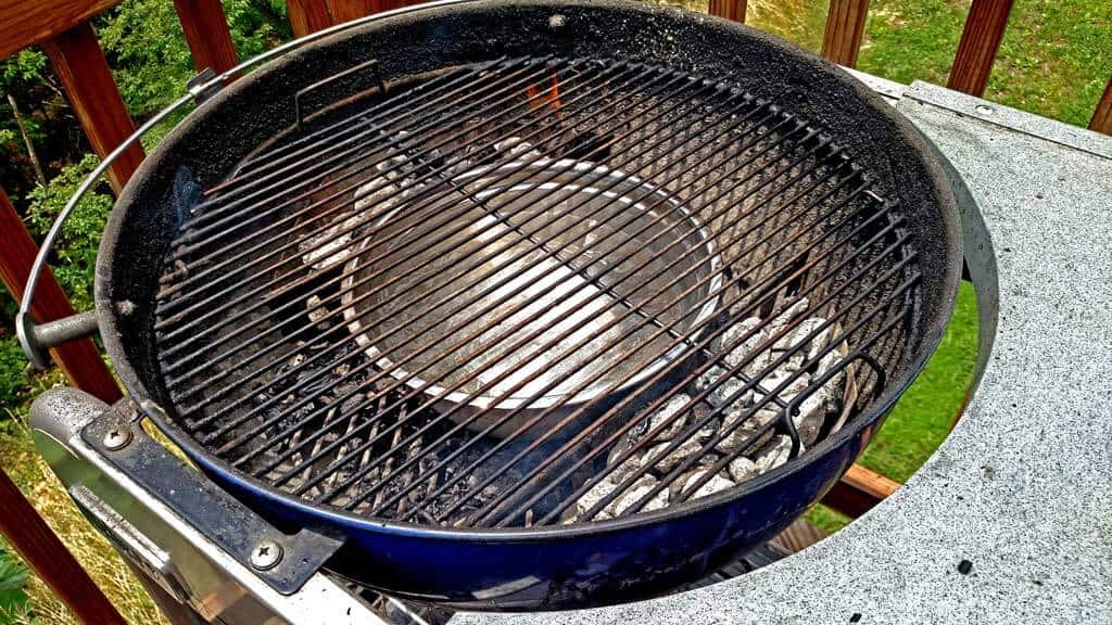 grill set up with the water bowl in the middle surrounded by charcoal