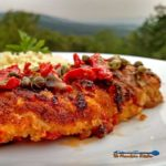 Sun-Dried Tomato Crusted Chicken is a delight! The breast are lightly battered in a sun-dried tomato crust, topped with a rich and tangy sunny butter sauce.   TheMountainKitchen.com