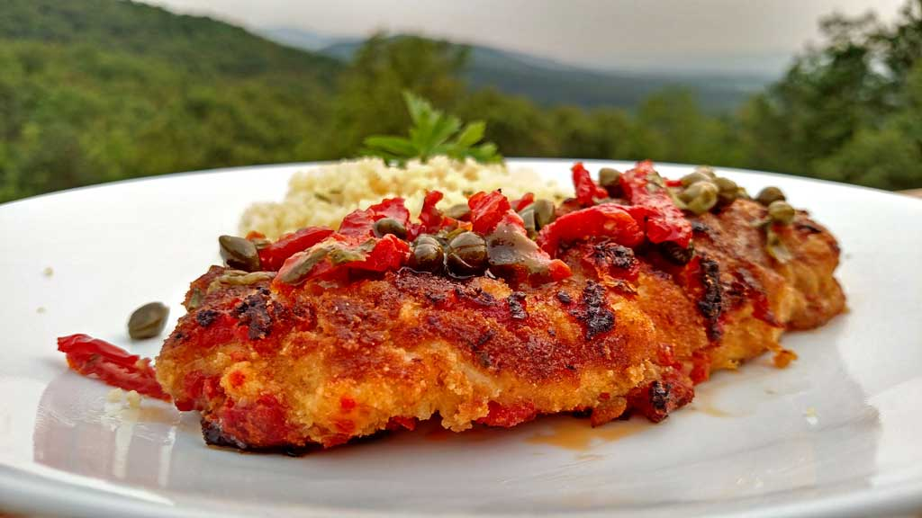 Sun-Dried Tomato Crusted Chicken is a delight! The breast are lightly battered in a sun-dried tomato crust, topped with a rich and tangy sunny butter sauce.