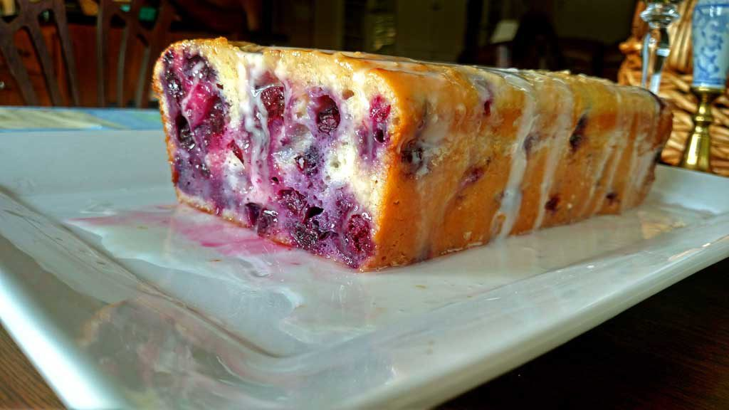 This Blueberry Lemon Yogurt Loaf captured that hot summer morning picking blueberries at my mama's house perfectly. This loaf has quite the zing to it and it is bursting with lemon flavor and fresh blueberries. It practically melts in your mouth and I am sure it would bring warm summer thoughts to your mind even in the dead of winter!   TheMountainKitchen.com