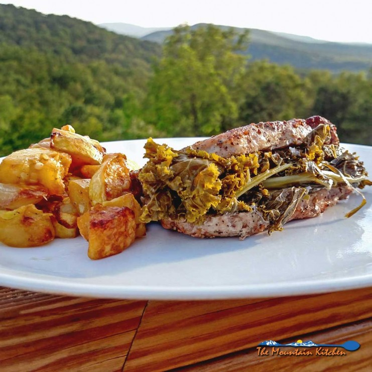 This great southern style Sunday supper may take a little time, but these Kale Stuffed Pork Chops have the potential to change the minds of green-haters. | TheMountainKitchen.com