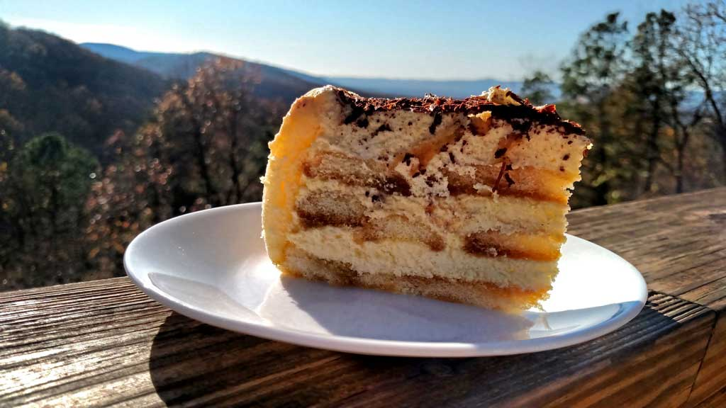 Homemade Tiramisu is a cake with layers of coffee flavored ladyfingers divided by a fluffy custard of Mascarpone cheese, topped with chocolate and cocoa. | TheMountainKitchen.com