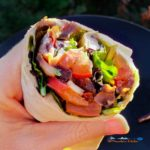 Quick, delicious and fresh, these veggie wraps with red bell peppers, onions and mushrooms sauteed and tucked inside a wrap with lettuce, hummus and goat cheese.