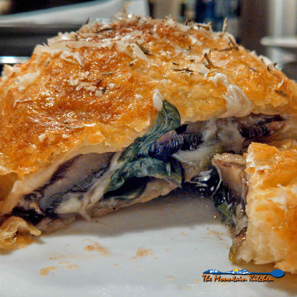 The Meatless Monday Top 10 Recipe Countdown of 2016! | This recipe is a spin-off the classic Beef Wellington recipe, this vegetarian version uses Portobello mushroom caps, spinach and cheese stuffed inside of a flaky pastry crust. | TheMountainKitchen.com