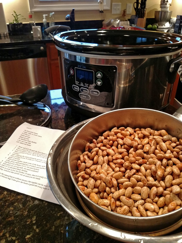 crock-pot with drained dried pinto beans in bowl