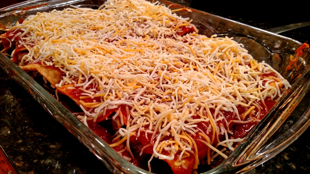 enchiladas coated with cheese