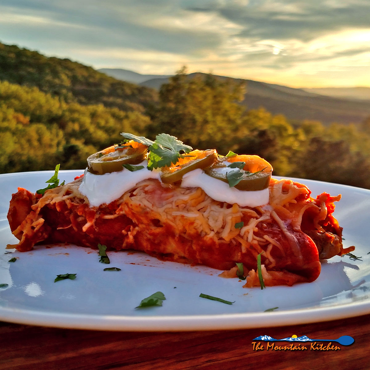 Steak and Refried Bean Enchiladas: rolled flour tortillas filled with refried beans, and steak topped with enchilada sauce and cheese.