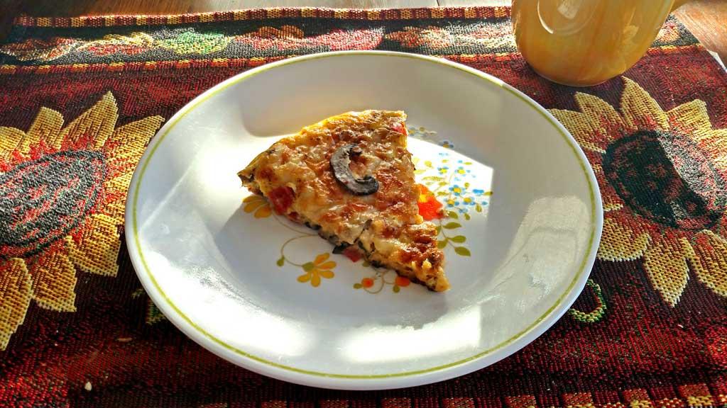 slice of vegetable fritatta on plate
