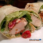 Chicken Caesar Wraps | These Chicken Caesar Wraps have juicy chicken tenders, wrapped inside a tortilla with crispy romaine lettuce, cherry tomatoes, feta and parmesan cheese, then dressed with your favorite Caesar dressing with crumbled pepperonis for extra flavor. | TheMountainKitchen.com