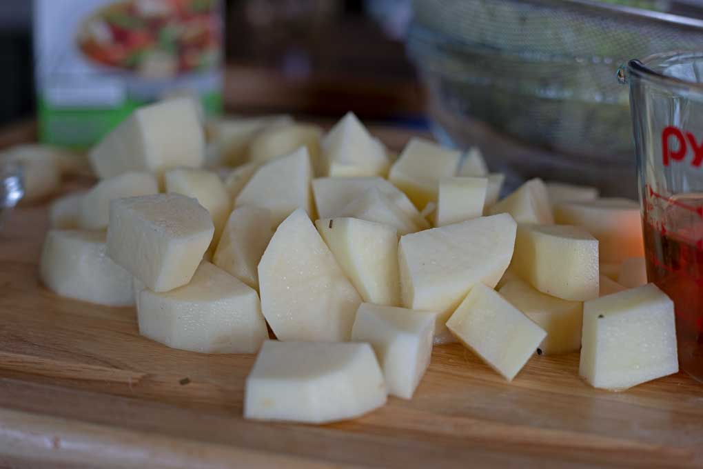 chopped potatoes on cutting board
