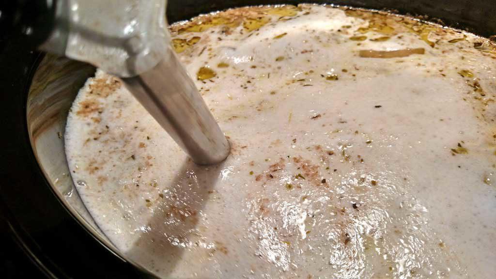 blending soup with immersion blender