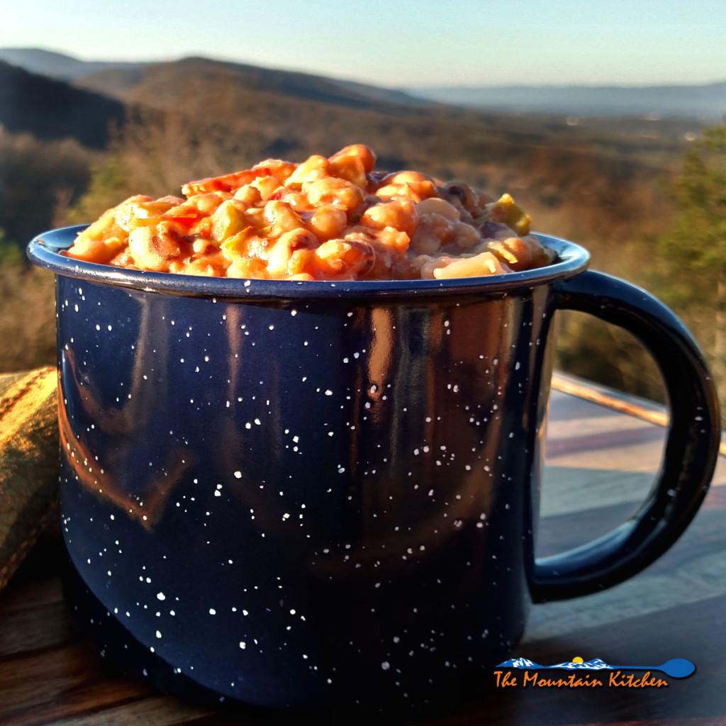mug of Hoppin John with mountain view