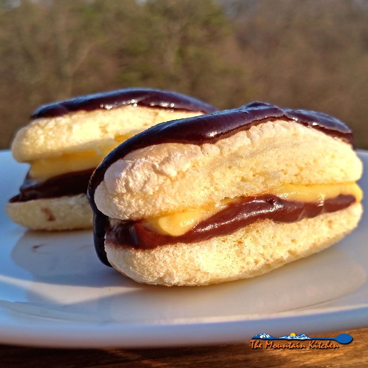 Easy to make, Ladyfinger Mini Eclairs are made of ladyfingers layered with pudding, topped with chocolate sauce, and whipped cream,