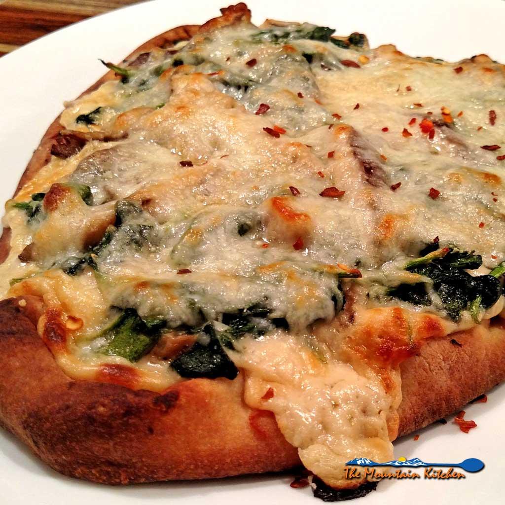 mushroom spinach alfredo flatbread pizza