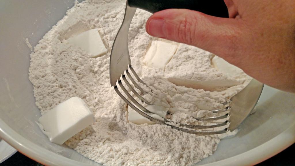 dough cutter cutting lard into flour