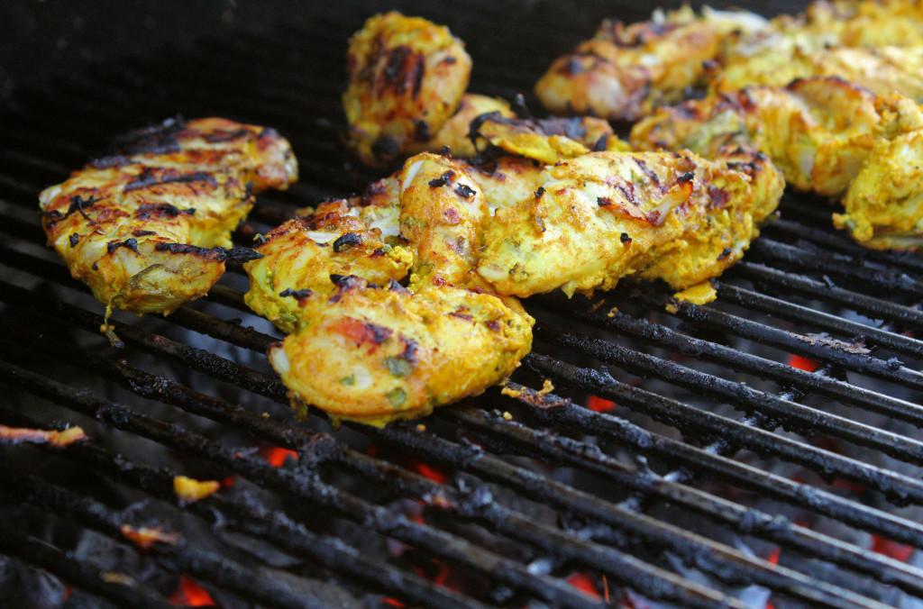 tandoori chicken cooking on grill