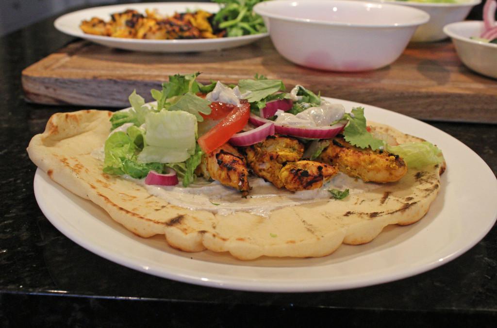 Tandoori Chicken served with yogurt sauce and naan bread