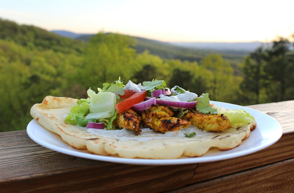 grilled tandoori chicken on naan bread with mountain view