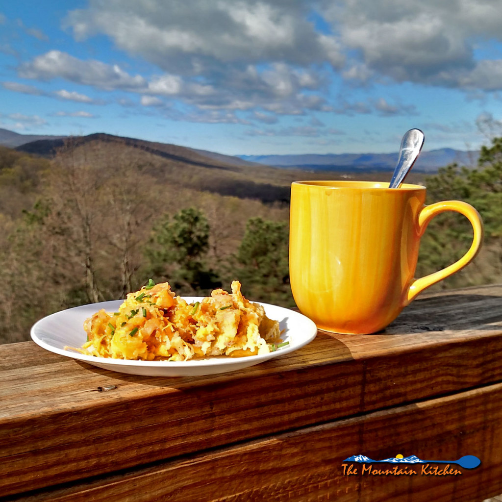Camper's Breakfast Hash | Start your day off right, with an easy to make recipe that combines breakfast favorites; shredded hash browns, breakfast sausages, cheese and eggs into a one-pan wonder. It can be cooked on an open fire or you can enjoy the comfort of your own kitchen like we did. | TheMountainKitchen.com