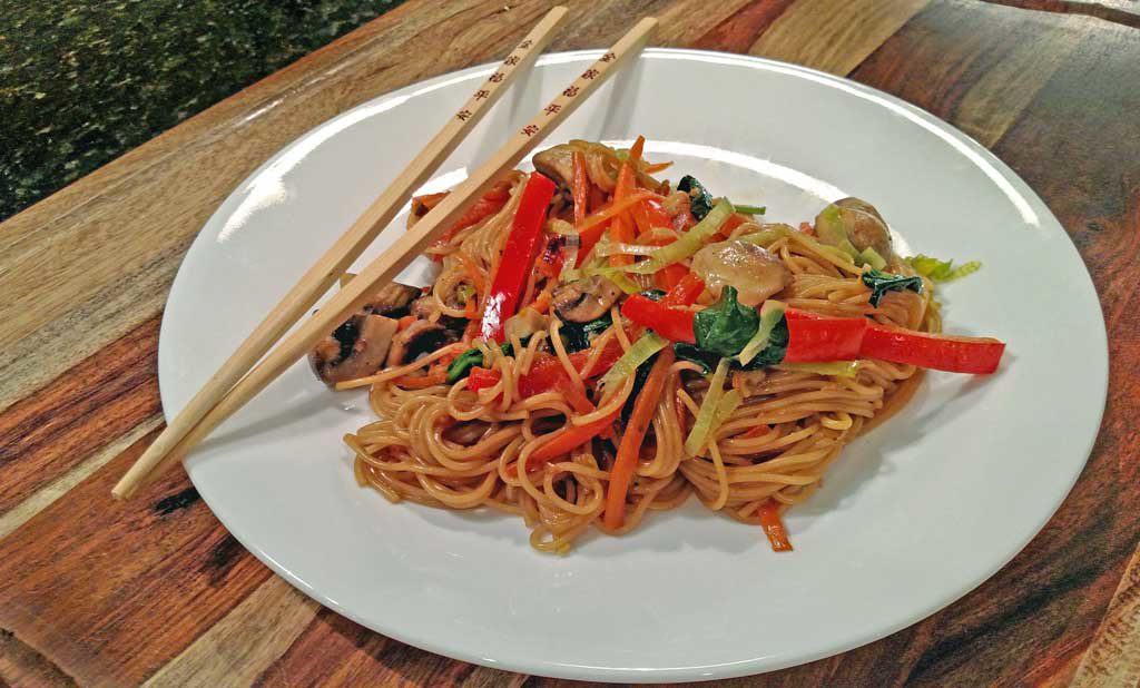 fake lo mein on plate with chopsticks ready to eat