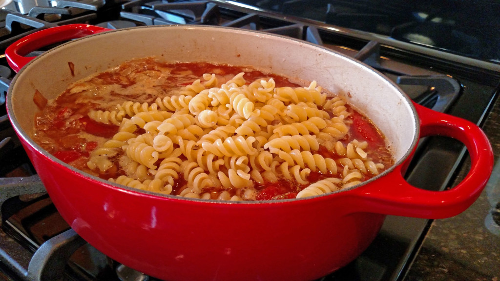 pasta in pot of soup on stove