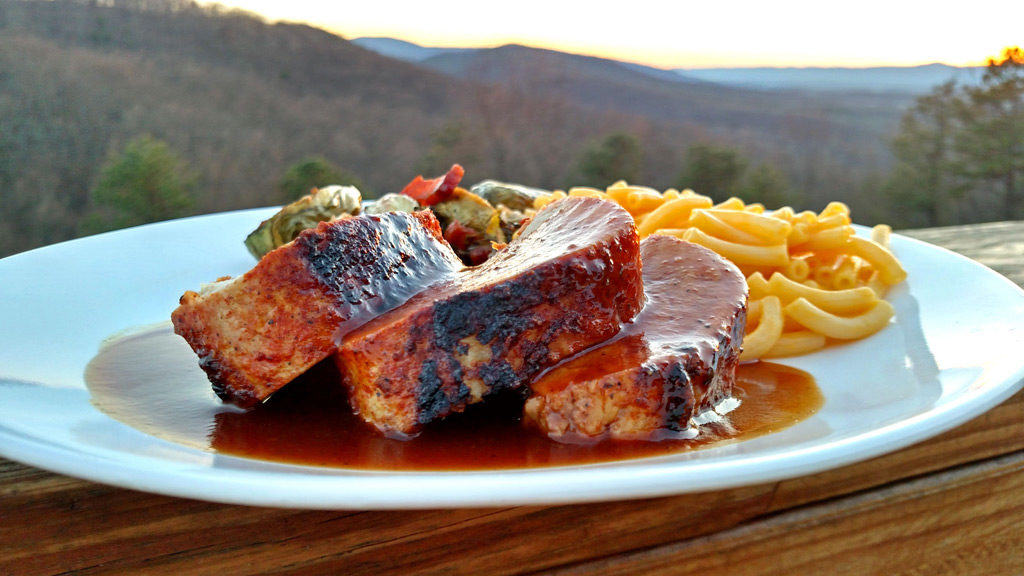 Oven-Baked BBQ Pork Tenderloin on plate with mountain view