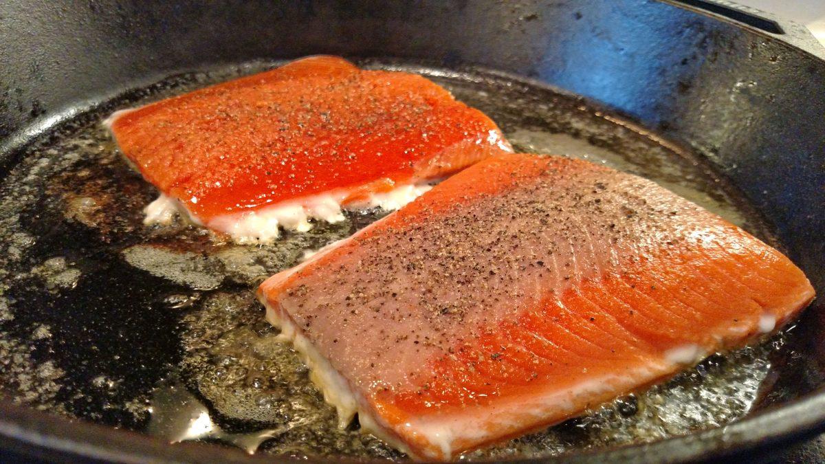 salmon cooking in pan
