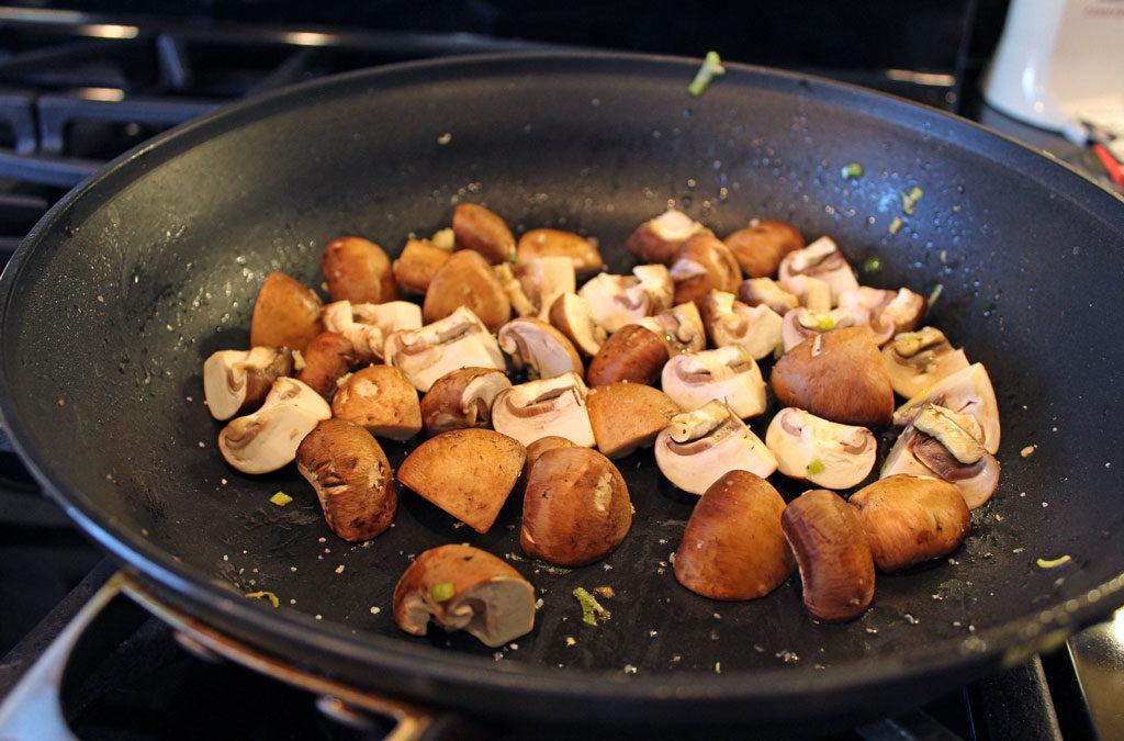 mushrooms cooking in skillet