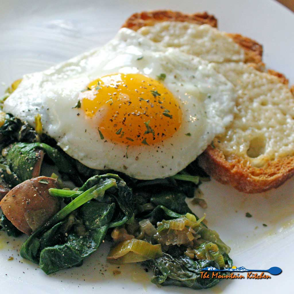 This big plate of fried eggs, cheesy toasts, and delicious sautéed leeks and mushrooms is simple, and can be eaten any time of day!