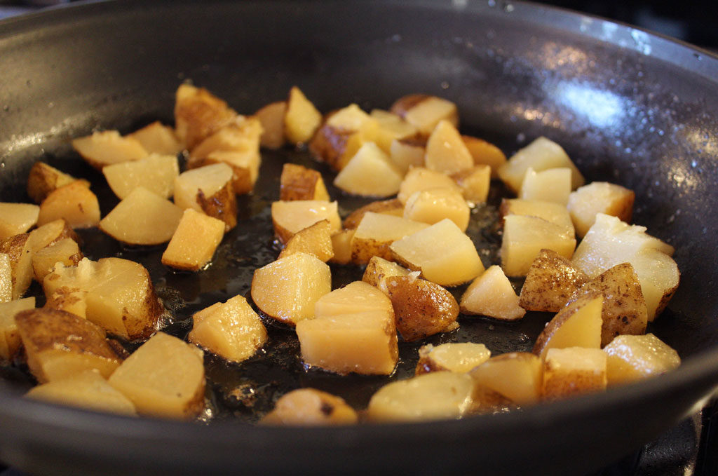 potatoes cooking in the pan