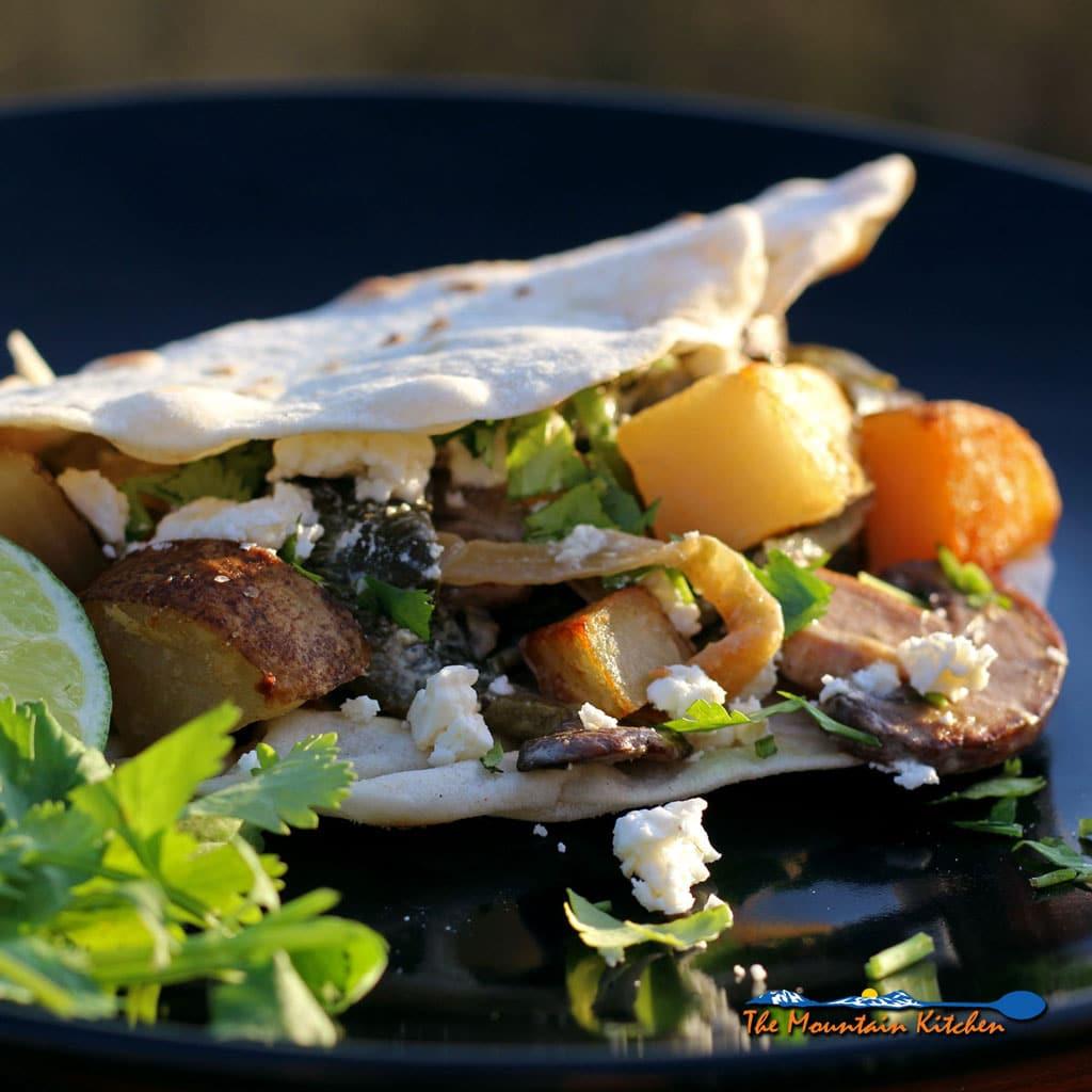 Poblano Mushroom and Potato Taco on plate ready to eat