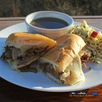 Dripping with goodness the beef for these Slow-Cooker French Dip Sandwiches is slow cooked for hours, served on toasted rolls with melted cheese and au jus. | TheMountainKitchen.com
