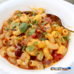 Cajun chili mac in bowl with spoon