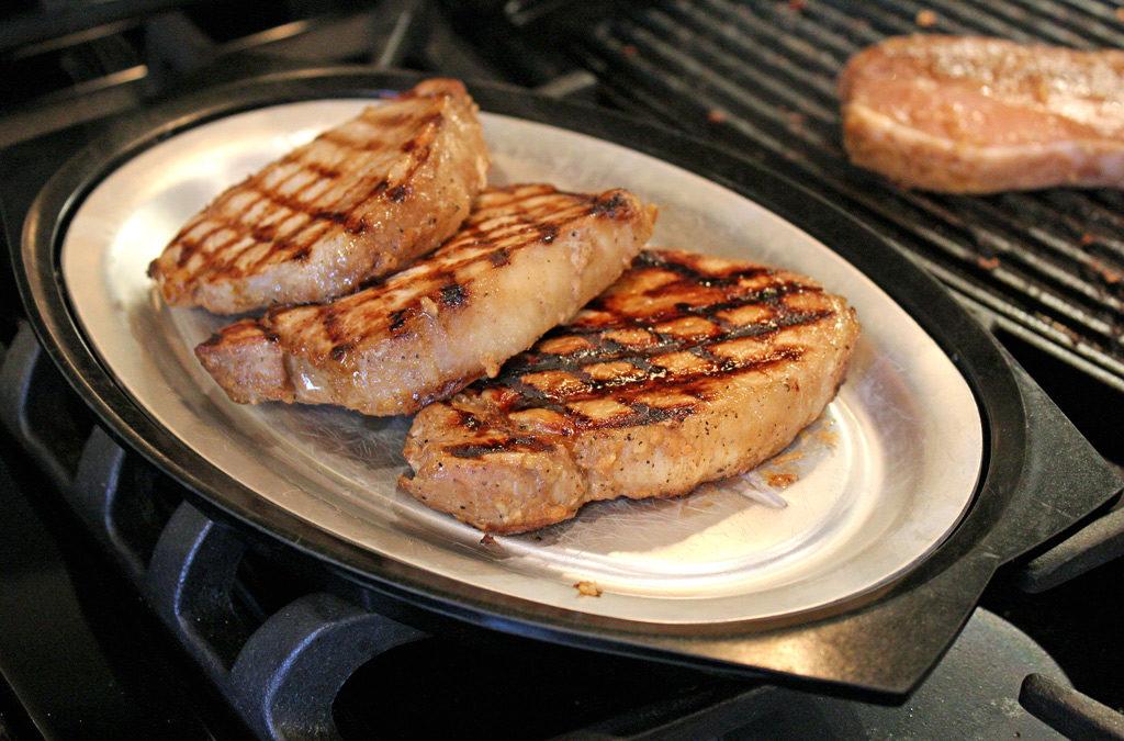 grilled teriyaki pork chops on platter