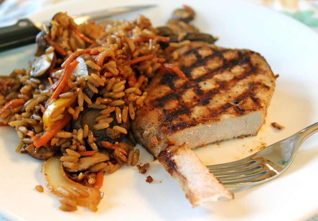 grilled teriyaki pork chop with vegetables and rice