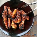 Grilled Cajun Chicken Wings on black plate