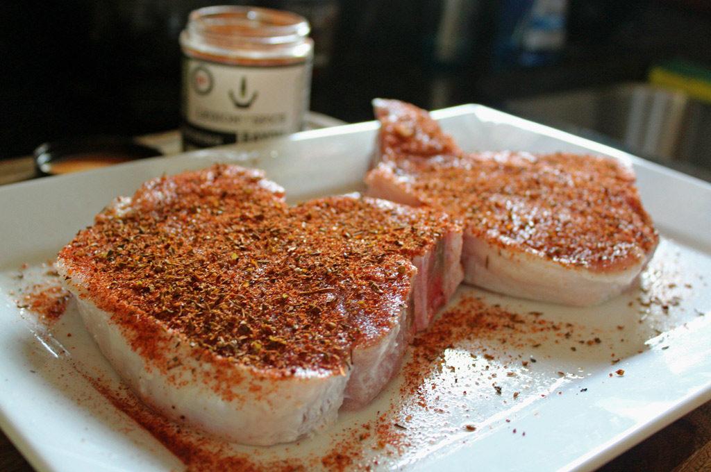 seasoned pork chops on platter
