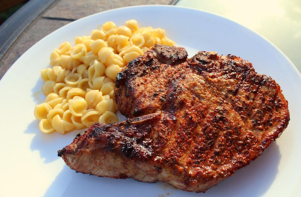 Cajun Grilled Pork Chop on plate with macaroni