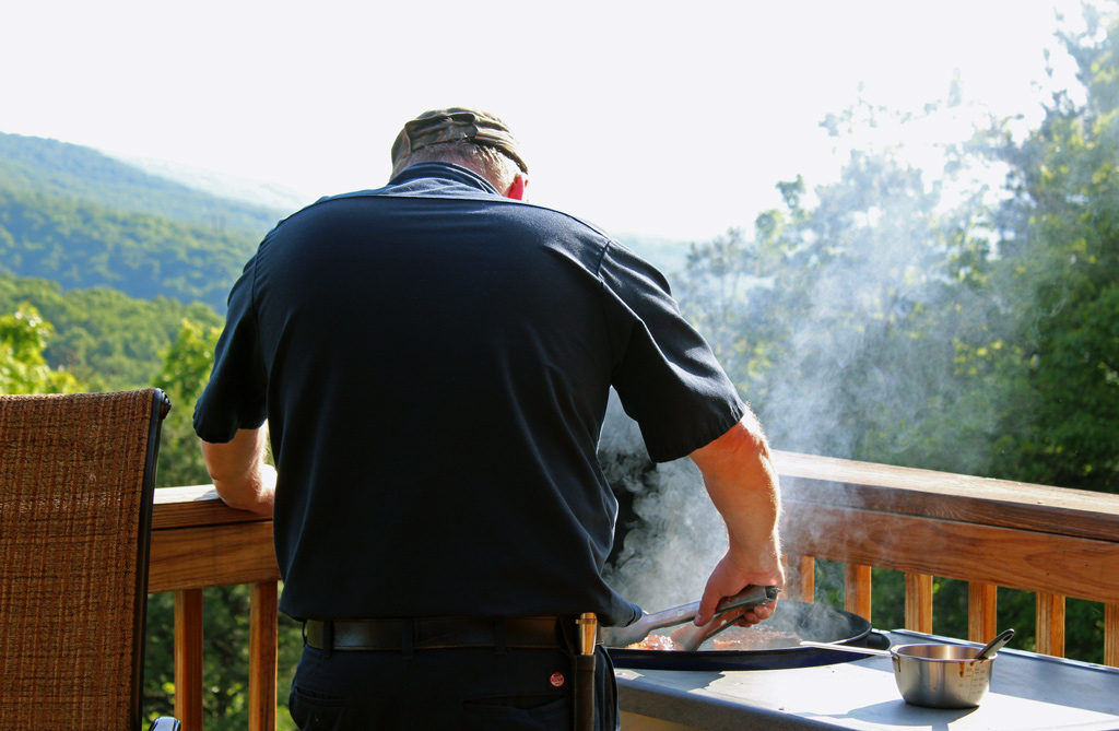 David grilling pork chops on deck
