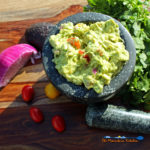 prepared guacamole in mortar bowl