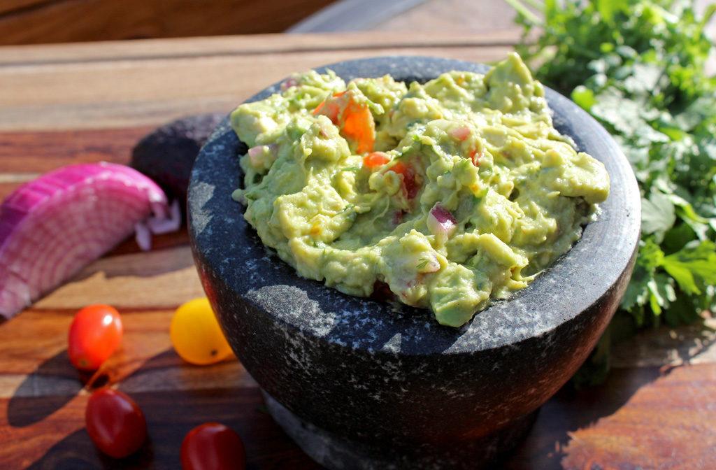 guacamole inside mortar bowl