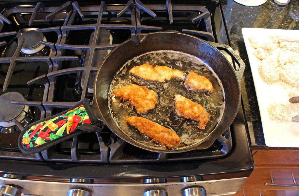 frying chicken tenders in pan