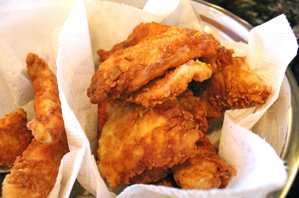 fried chicken tenders draining