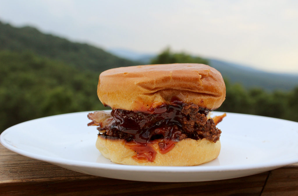 burger with sauce and mountain view