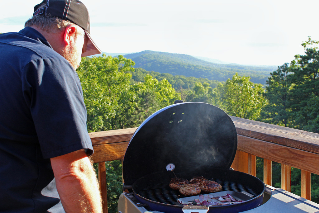 David watching grill with mountain view in background