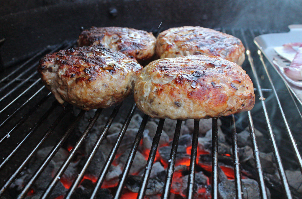 Curried Pork Burger cooking on grill
